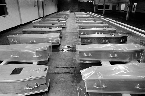 0_Coffins-in-a-disused-Liverpool-warehouse-waiting-for-gravediggers-to-end-their-strike-2